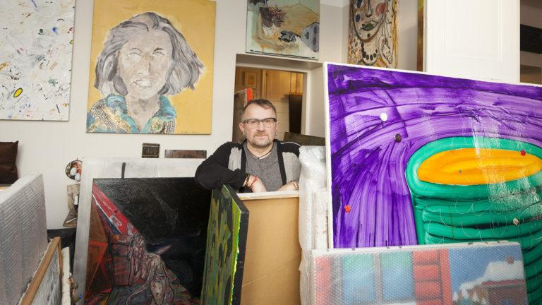 Collector Seppo Fränti surrounded by his collection.
